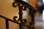 Detail of railing to an interior office space in 1075 Grand Concourse.