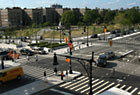 View across intersection of 161st Street to Joyce Kilmer Park from 888 Grand Concourse, designed by Emry Roth, currently a rental building.